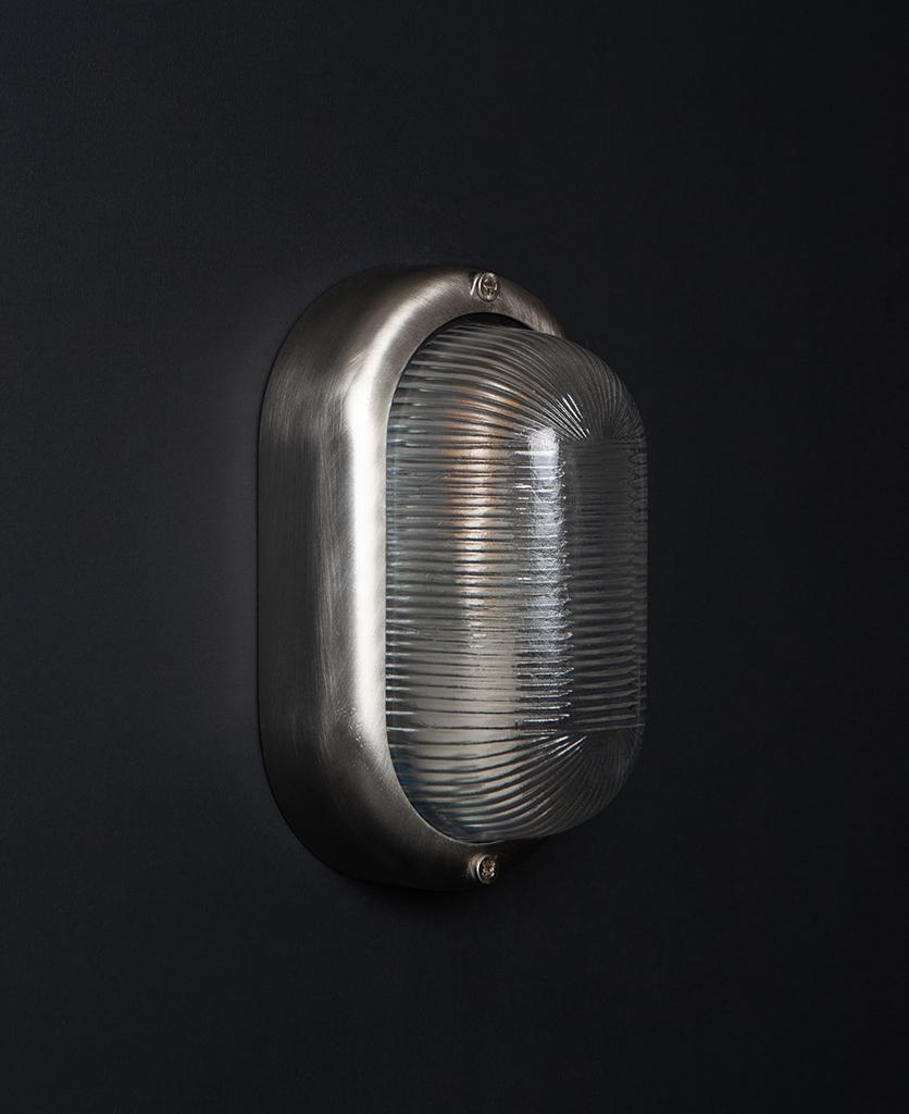 unlit silver mike led outdoor bulkhead light on black wall