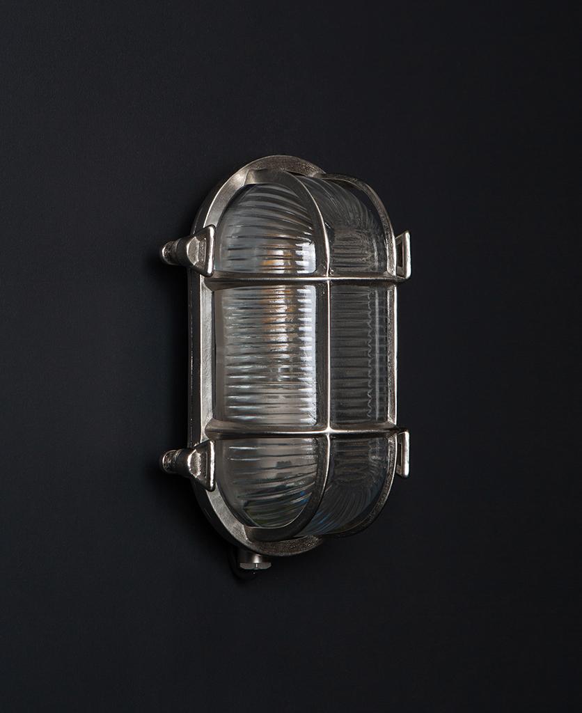 steve silver bulkhead outdoor lights with unlit bulb against black background