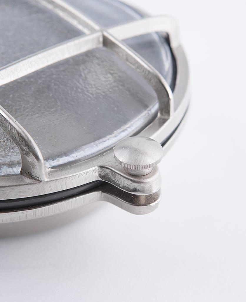 closeup of mark silver bulkhead light against white background