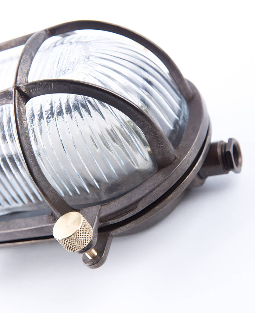closeup of steve bulkhead light with posh knurled knobs against white background