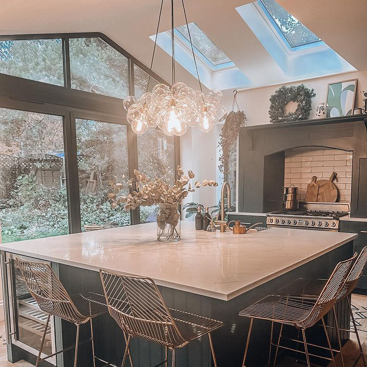 five point bubble chandelier suspended above kitchen island