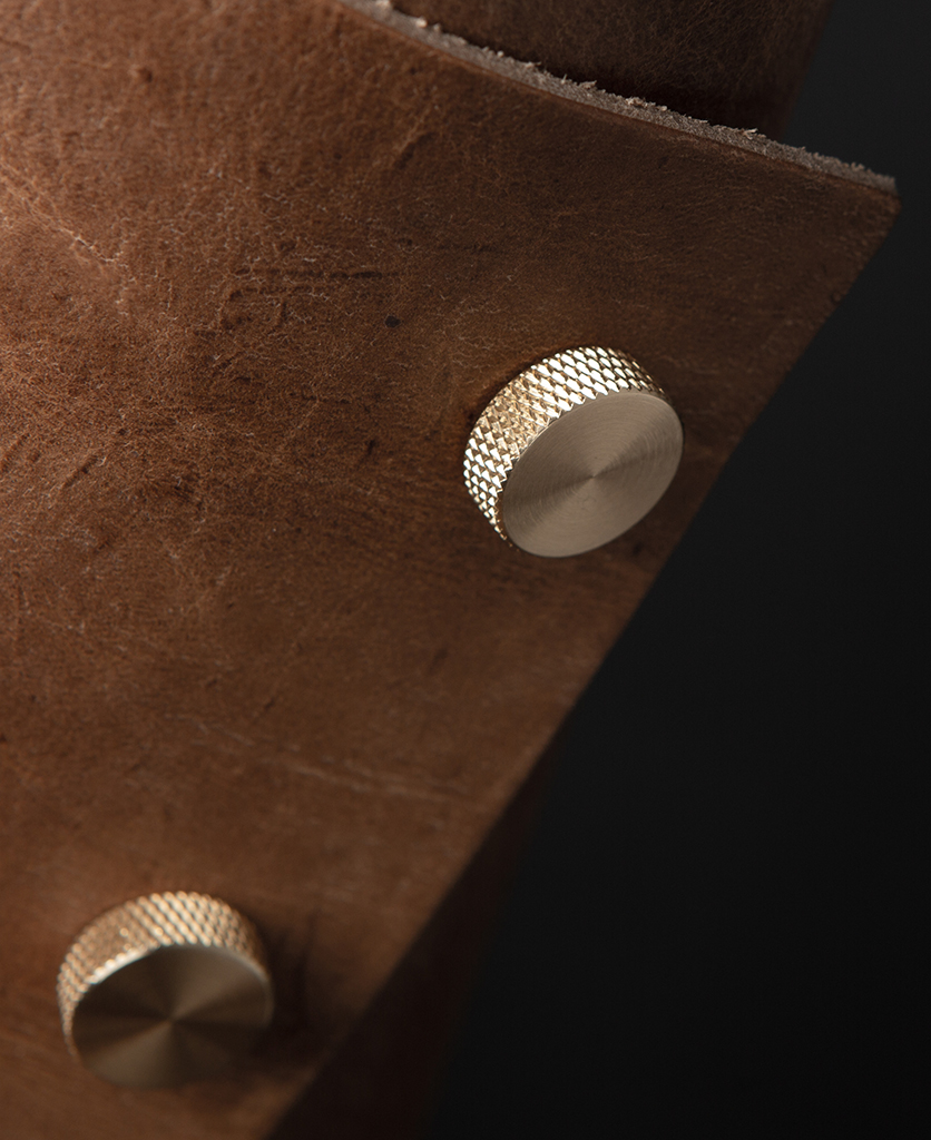 Tan and Brass Leather Cuff Lamp Close Up against black background
