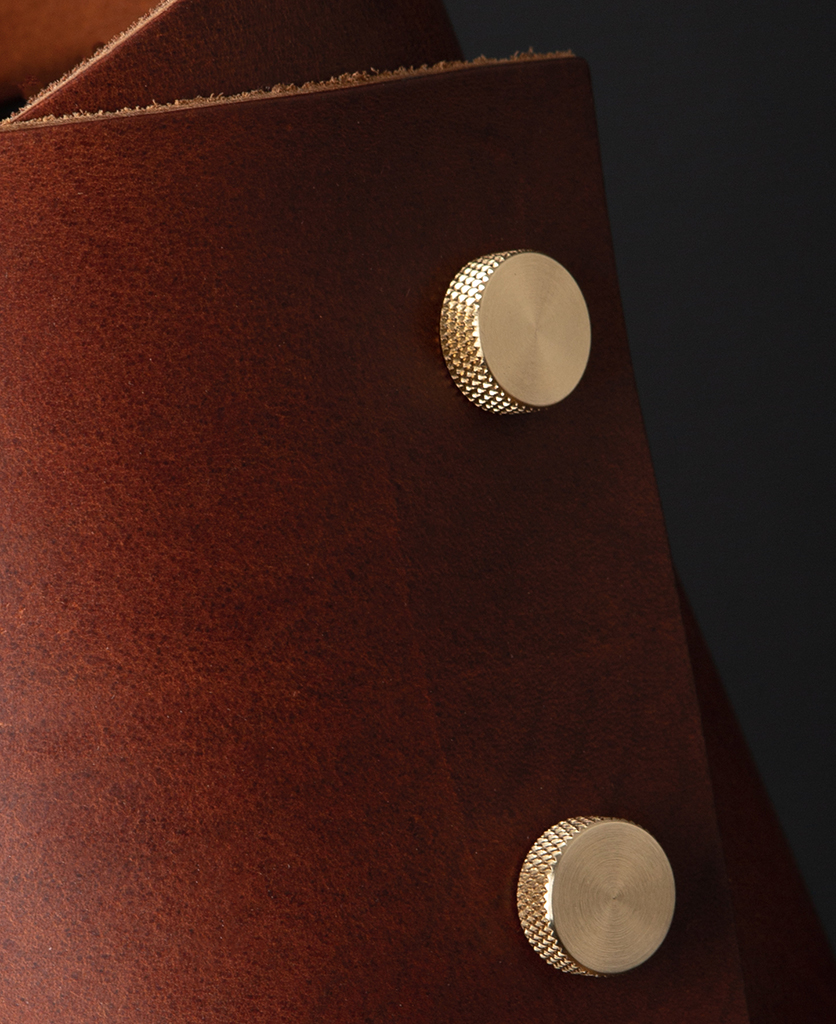 Oak and Brass Leather Cuff Lamp Close Up against black background
