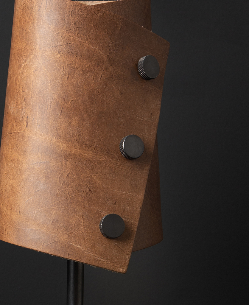 Tan and Antique Leather Cuff Lamp Close Up against black background