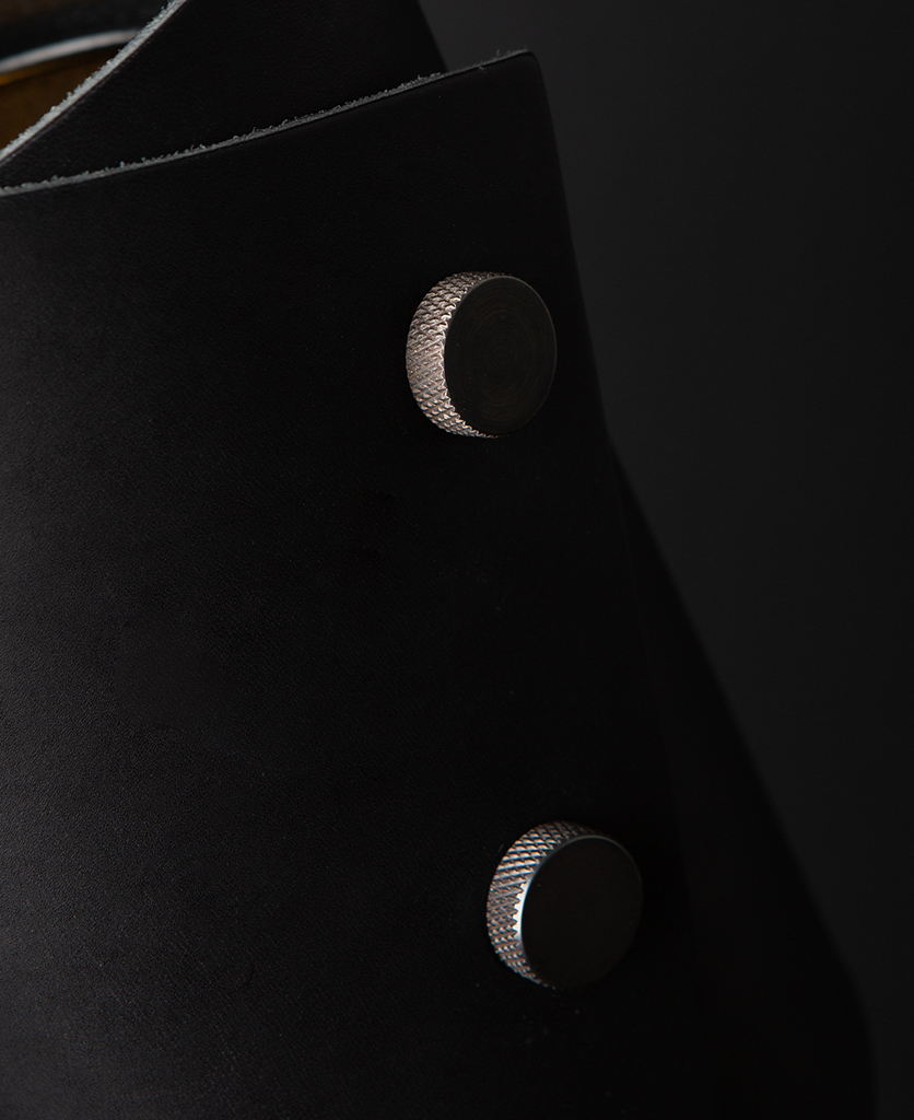 Black and Antique Leather Cuff Lamp Close Up against black background