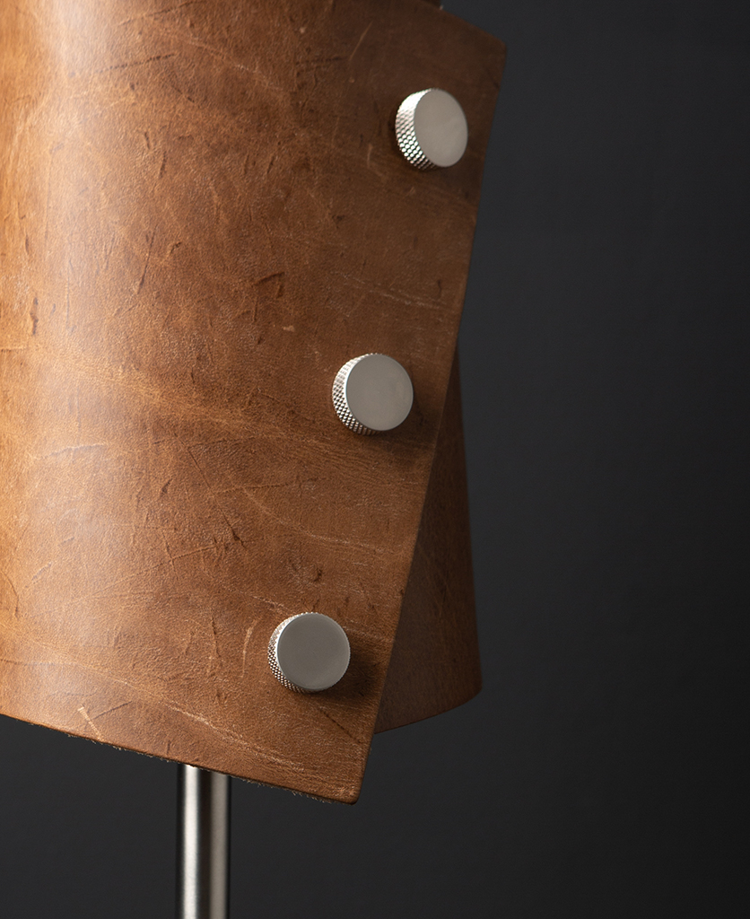 Tan and Silver Leather Cuff Table Lamp against black background
