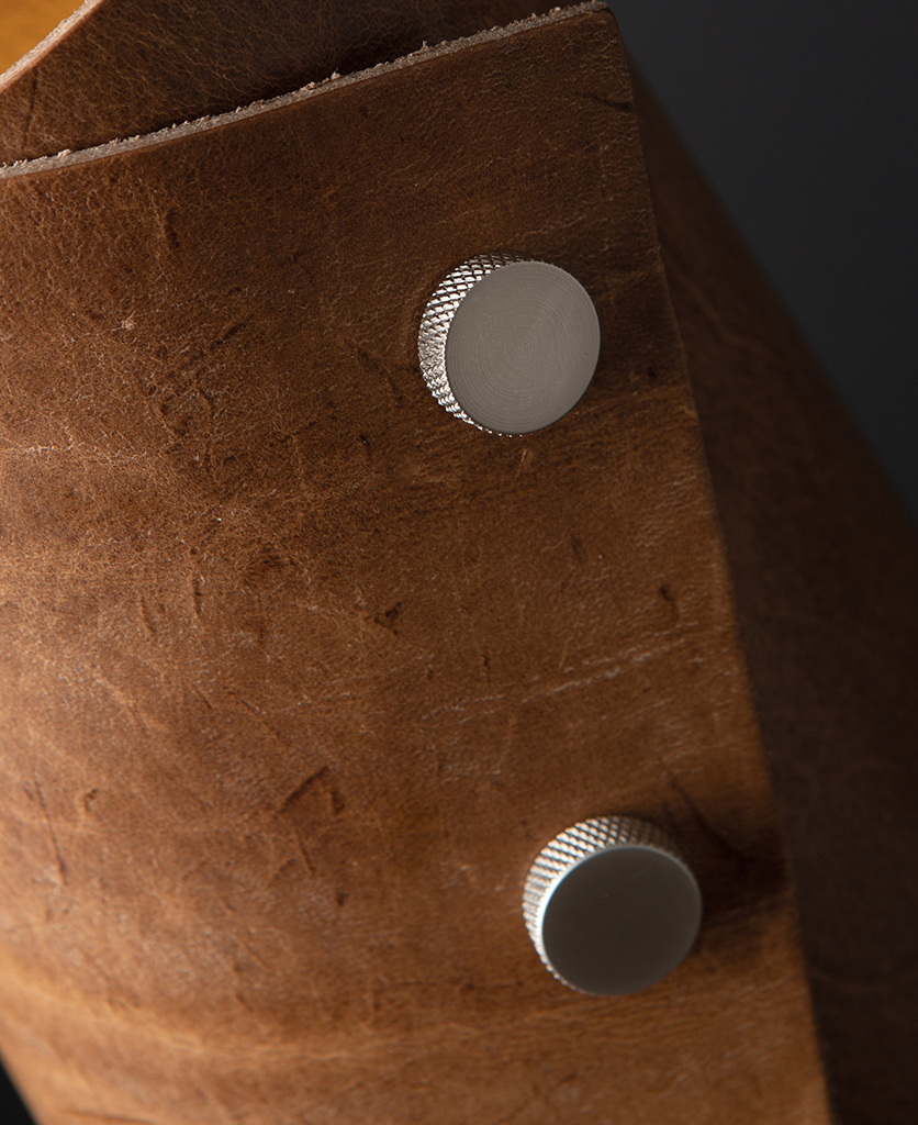 Tan and Silver Leather Cuff Table Lamp Close Up against black background