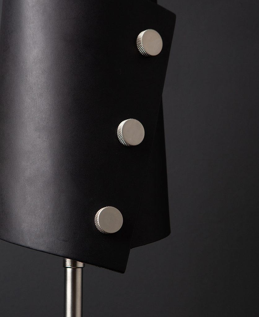 Black and Silver Leather Cuff Table Lamp against black background