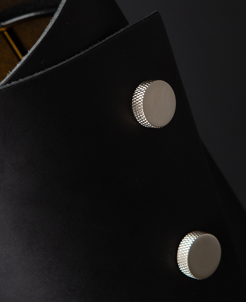 Black and Silver Leather Cuff Table Lamp Close Up against black background