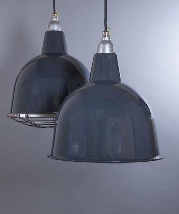 two grey stourton enamel metal pendant lights suspended from black fabric cable against light grey wall