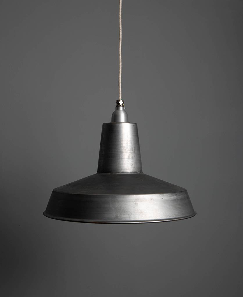 linton industrial pendant lighting raw steel shade suspended from linen fabric cable against grey background