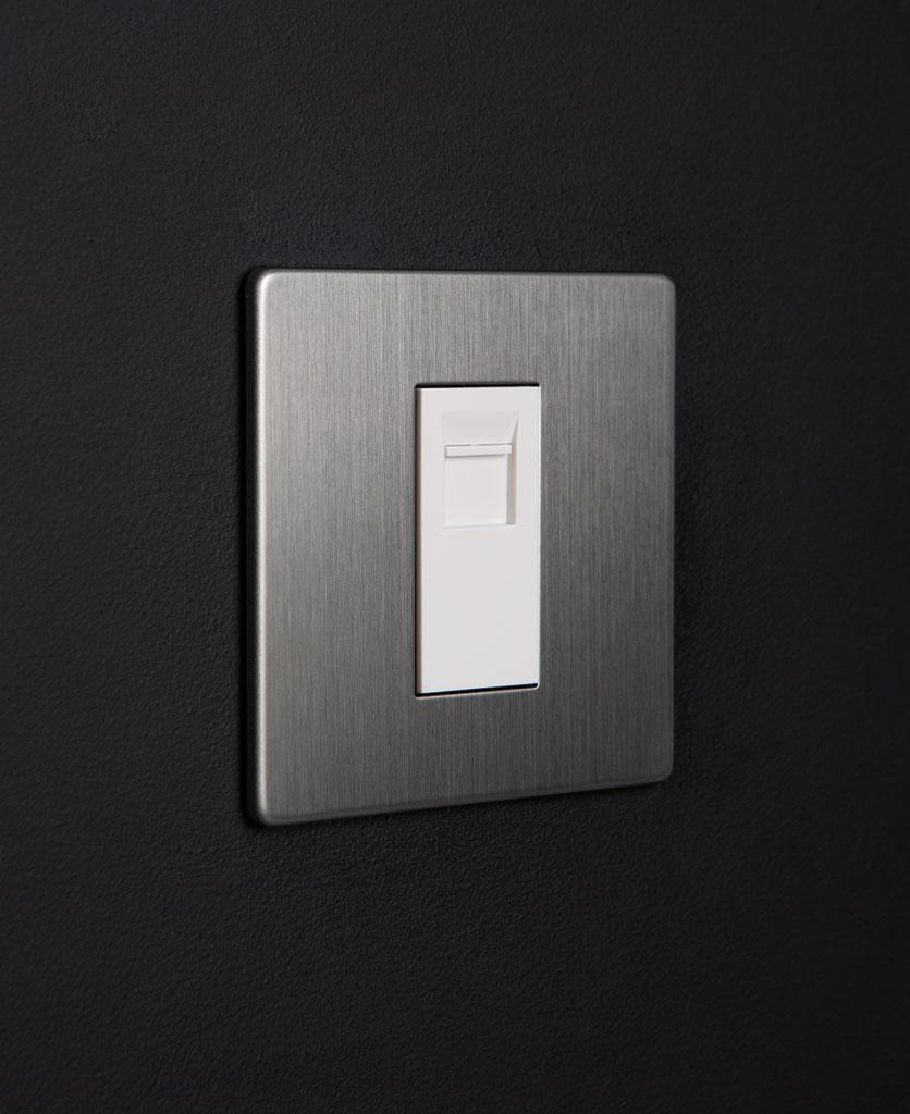 silver and white single data port against blackbackground