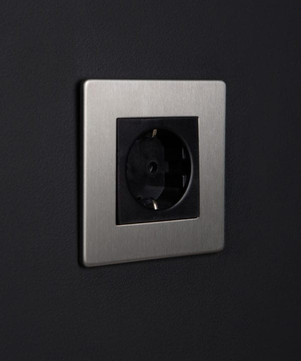 silver and black schuko socket against black backgroundgainst black background
