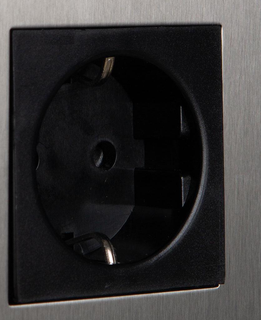 closeup of silver and black schuko socket