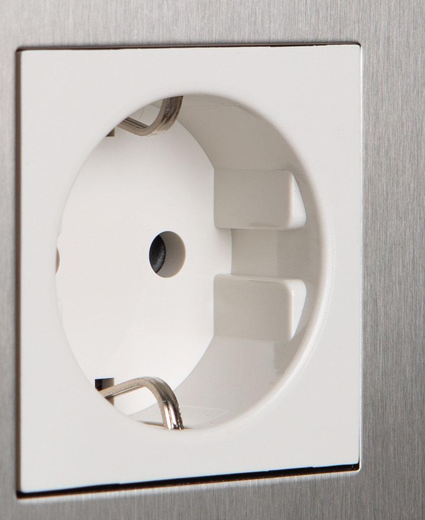 closeup of silver and white single schuko socket