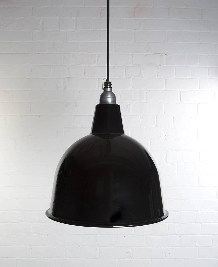 stourton black enamel metal pendant lights suspended from black fabric cable against white brick wall