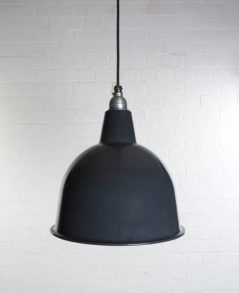 stourton grey enamel metal pendant lights suspended from black fabric cable against white brick wall