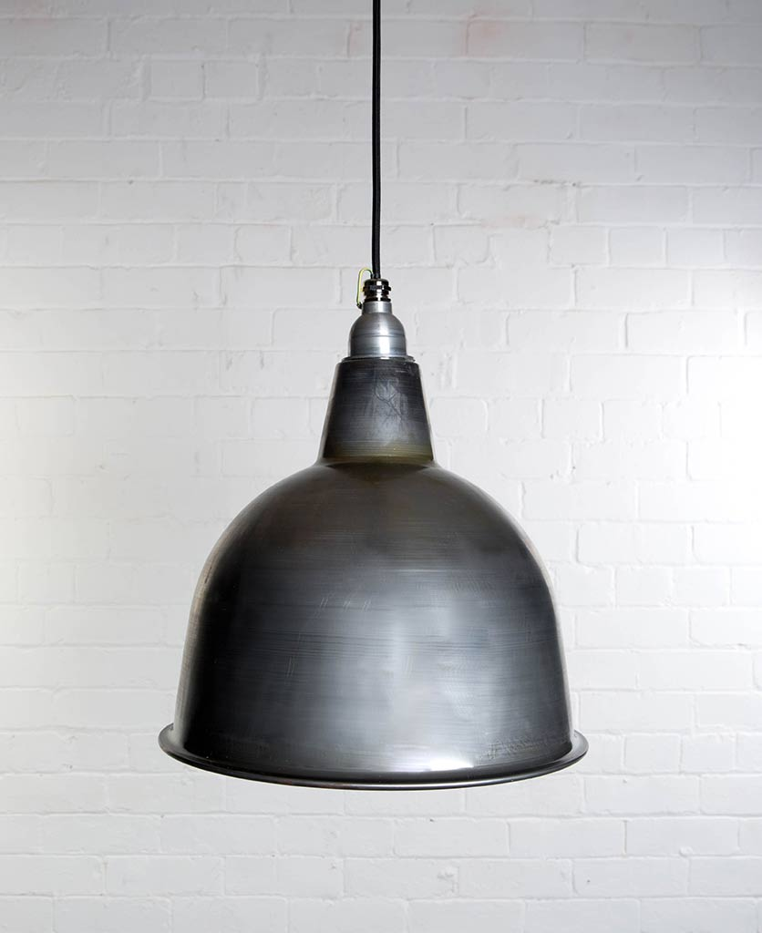 stourton raw steel enamel metal pendant lights suspended from black fabric cable against white brick wall