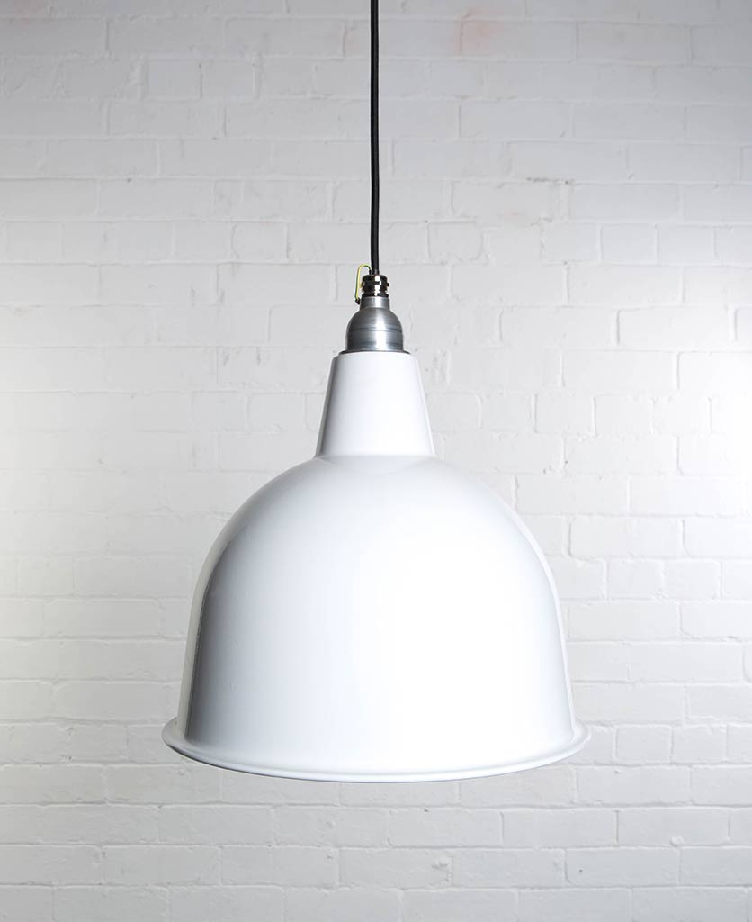 stourton white enamel metal pendant lights suspended from black fabric cable against white brick wall