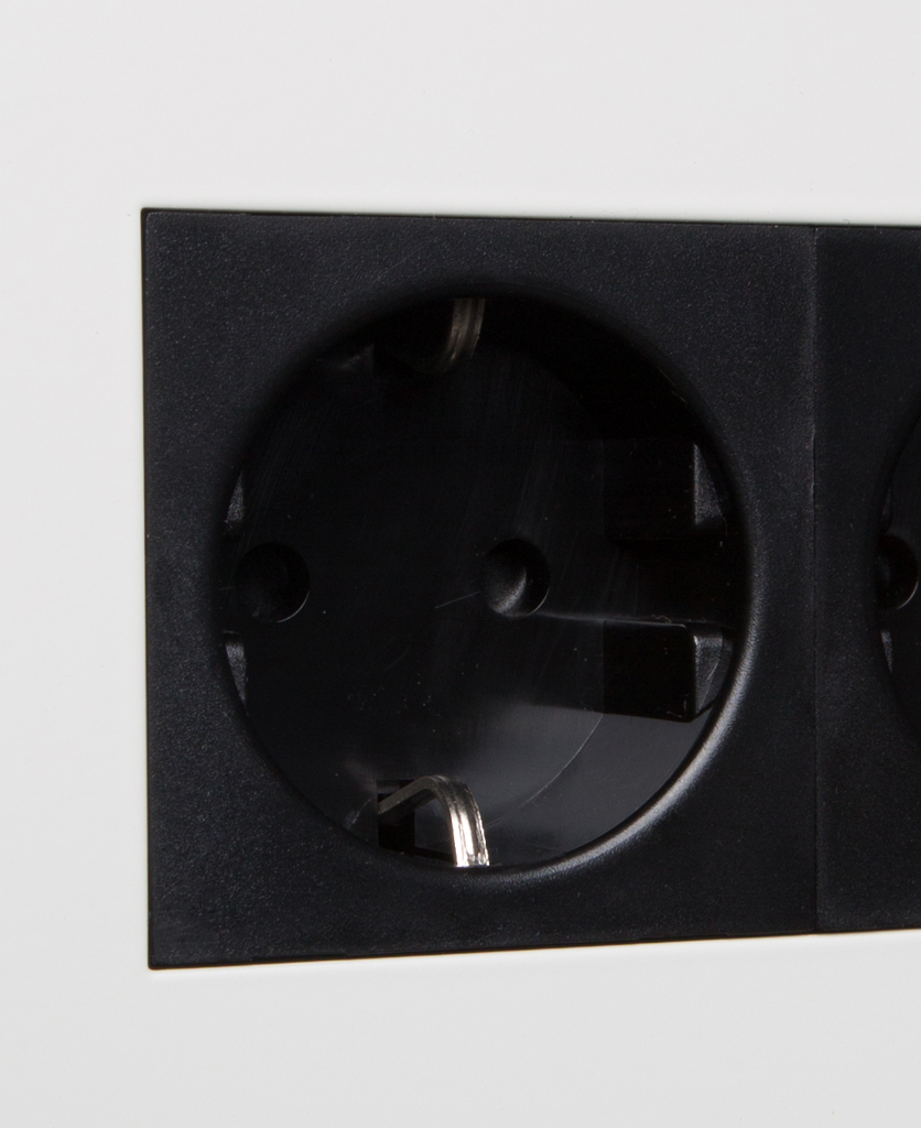 white and black double schuko socket close up