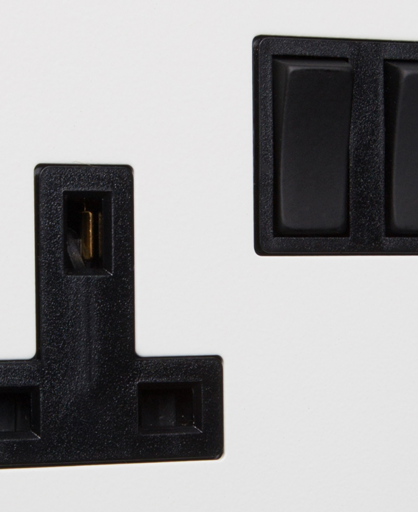 white and black double socket close up