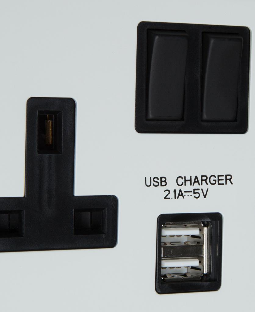 white and black double USB plug socket close up
