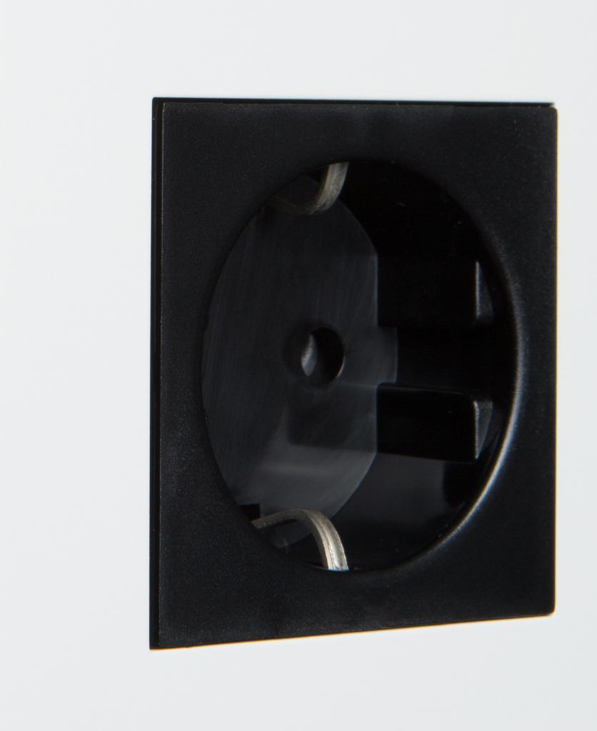 white and black single schuko socket close up