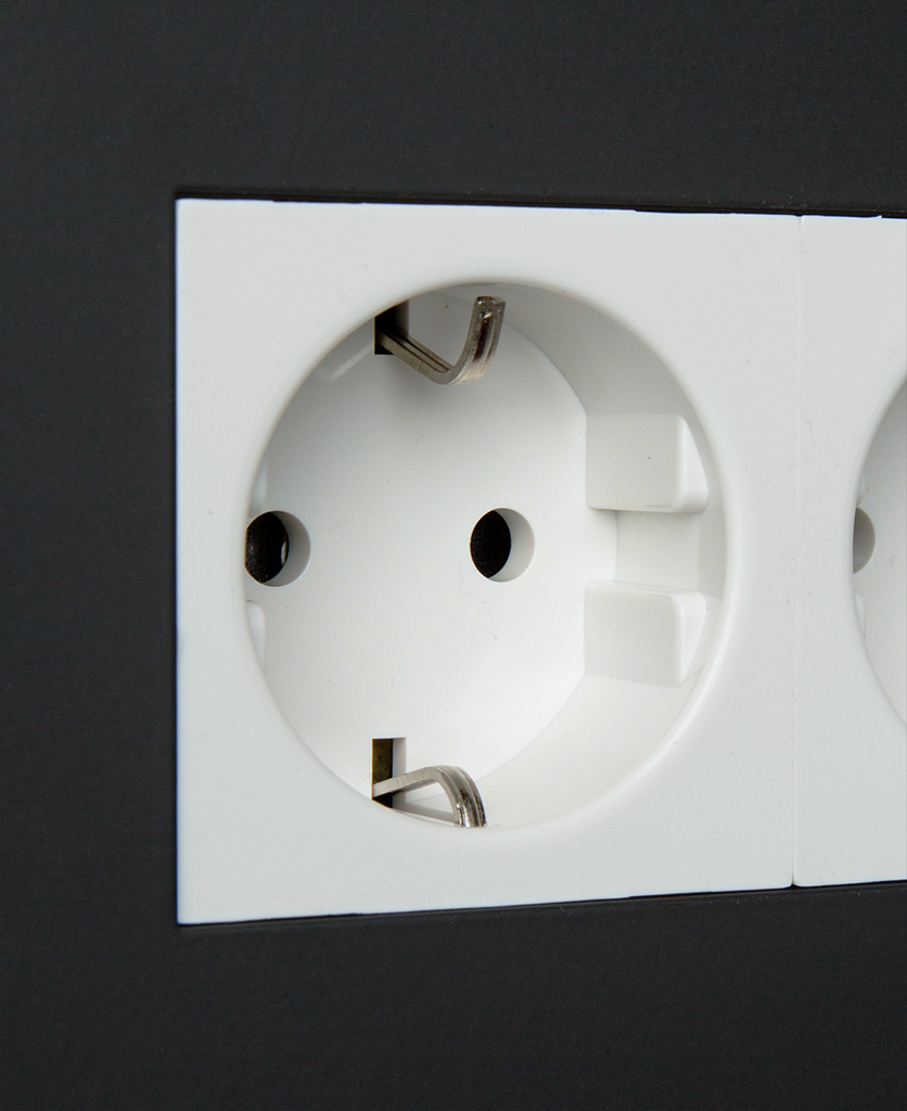 black and white double schuko socket close up