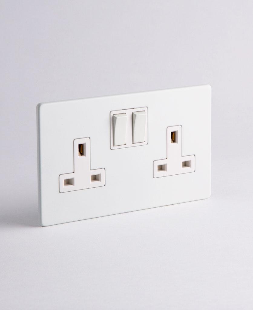 white & white double socket against white background