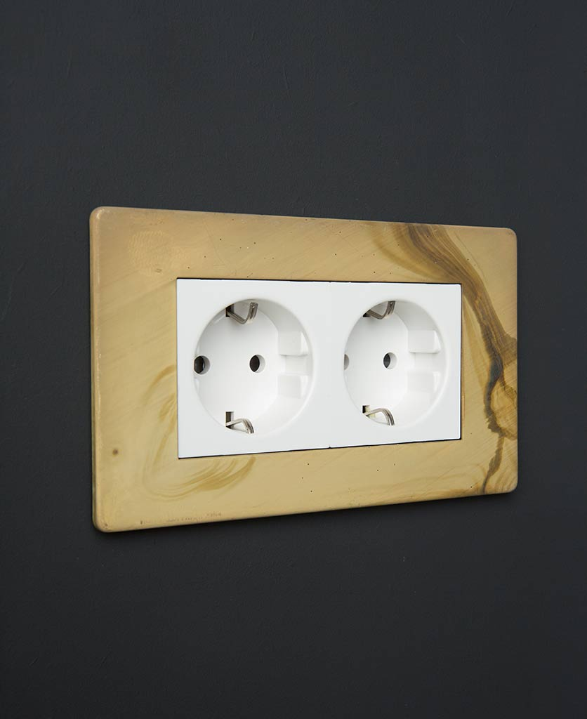 smoked gold and white double schuko socket against black background
