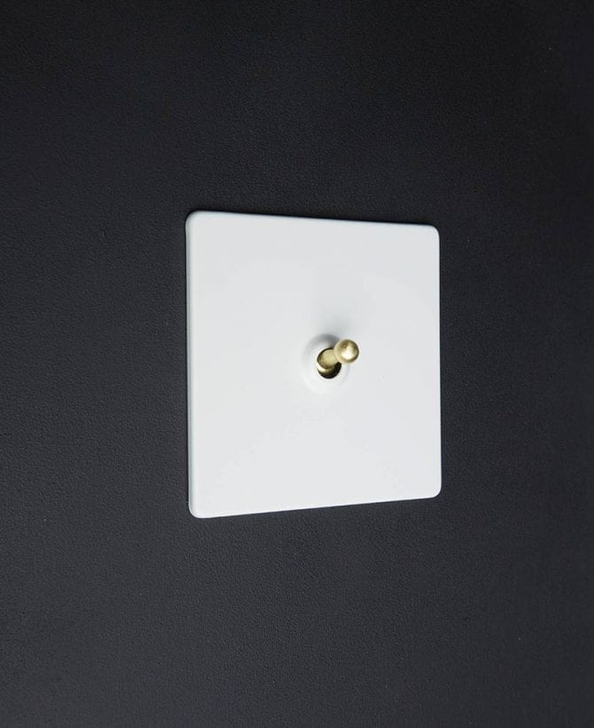 white & gold single toggle light switch