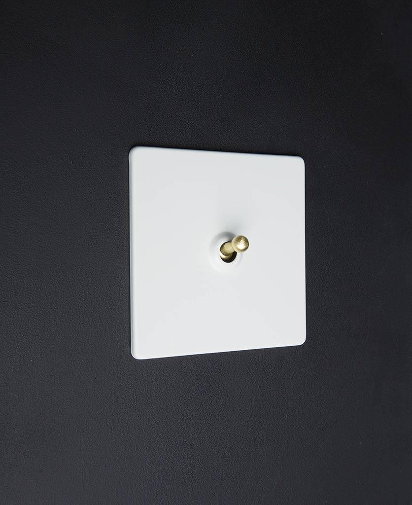 white & gold single toggle light switch