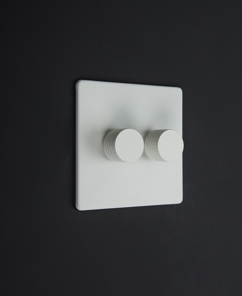 white & white double dimmer standard against black background