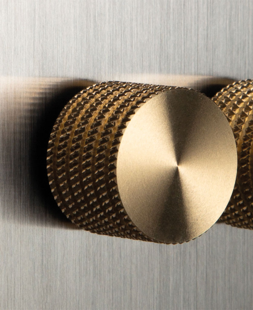 closeup of silver and gold double dimmer