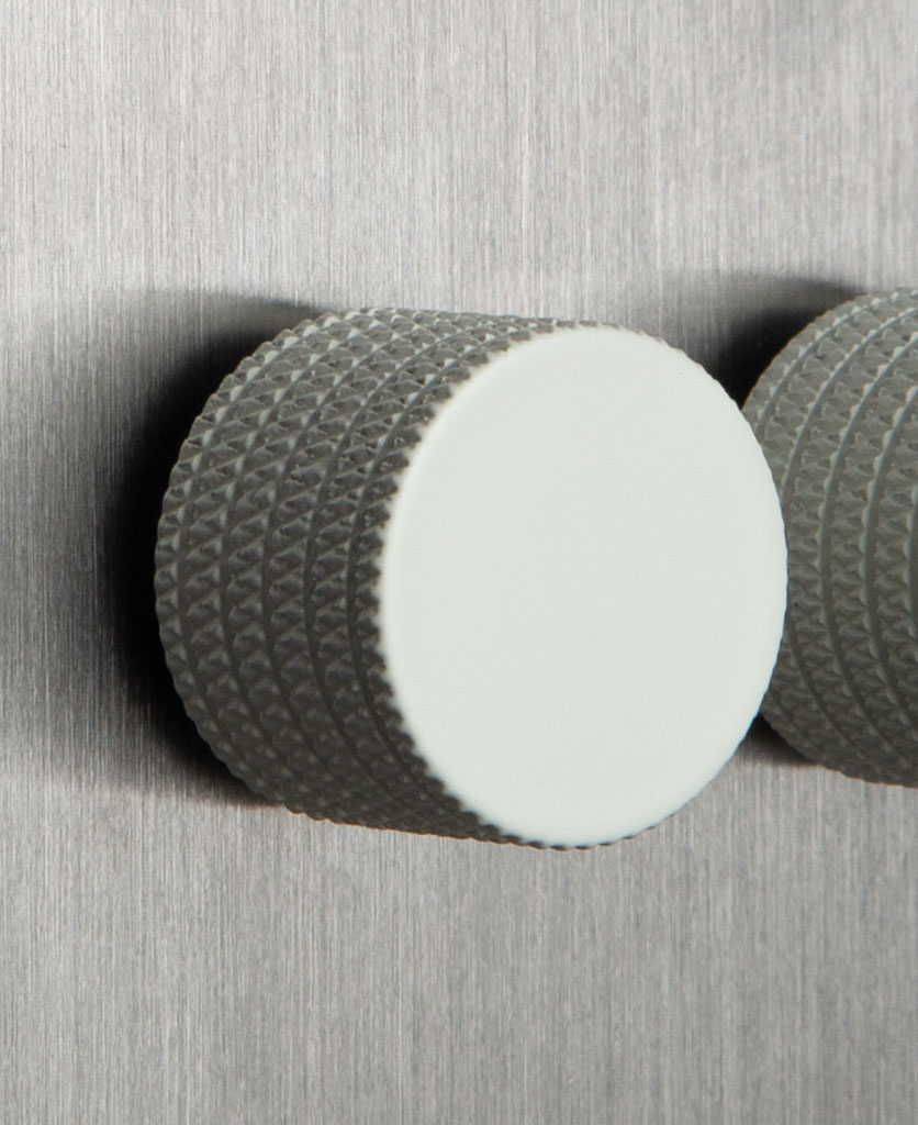 closeup of silver and white double dimmer