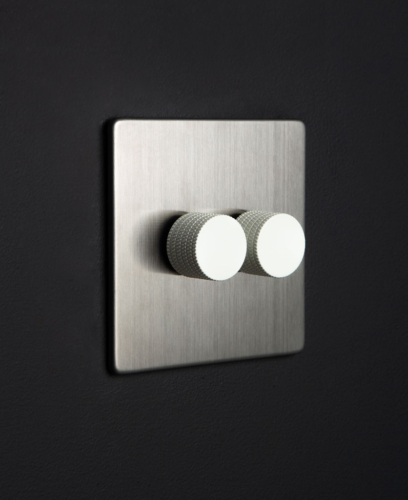 silver and white led double dimmer against black background