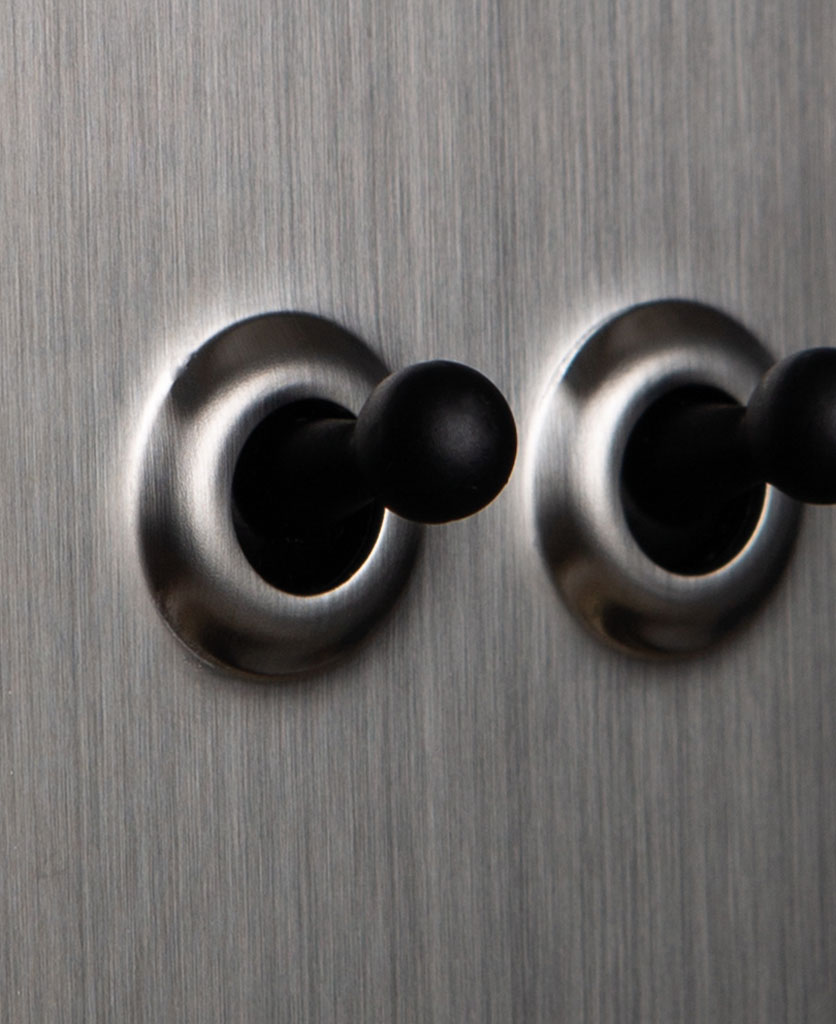 closeup of silver and black double toggle switch