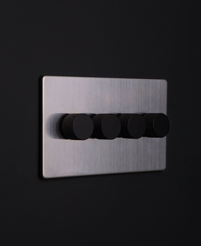 silver and black quad dimmer against black background