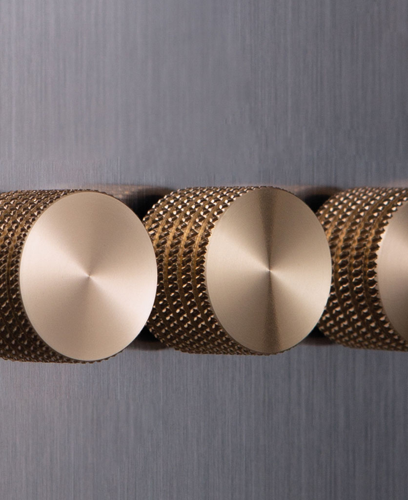 closeup of silver and gold quad dimmer