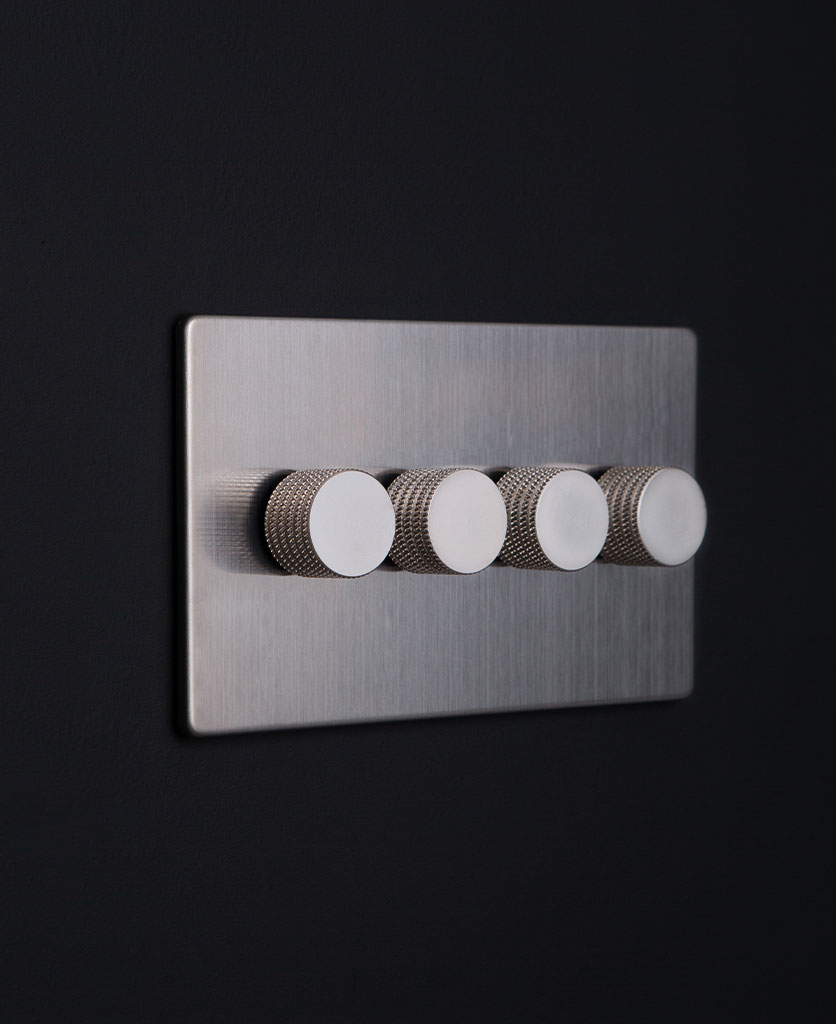 silver and silver quad dimmer against black background