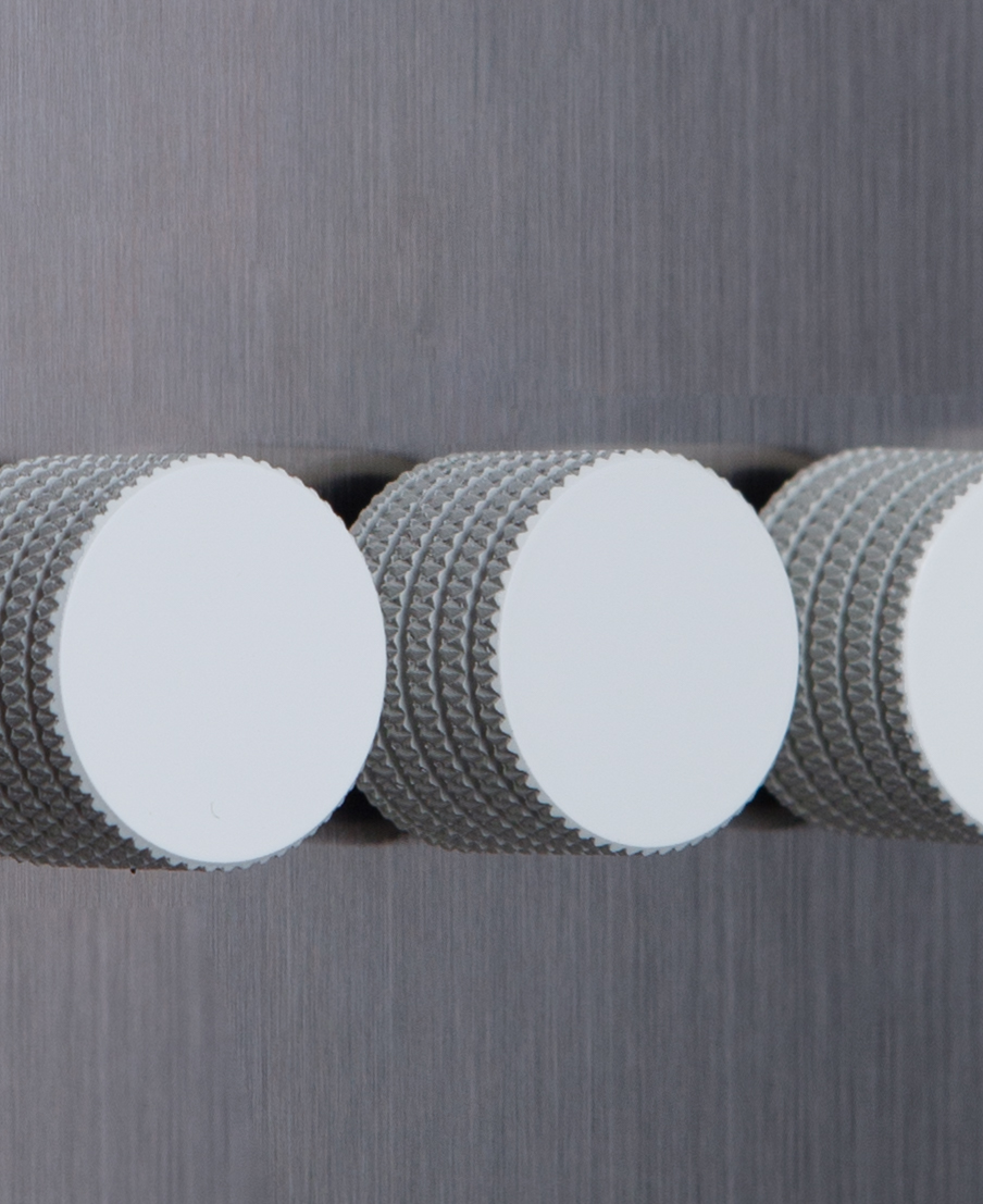 closeup of silver quadruple dimmer switch with white dimming knobs
