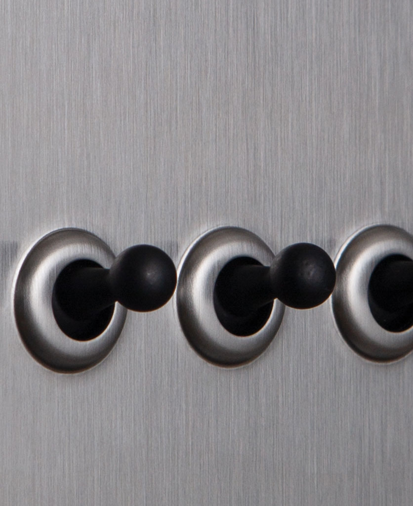 closeup of silver and black quad toggle switch