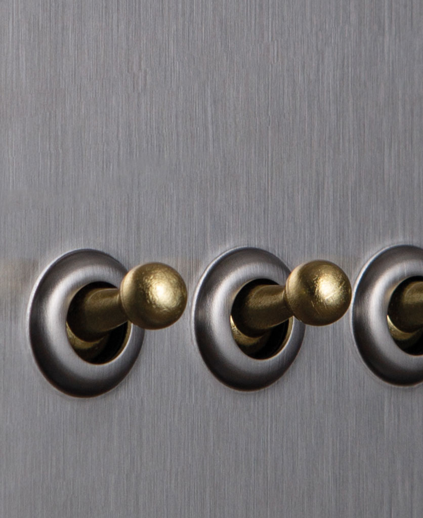 closeup of silver and gold quad toggle switch