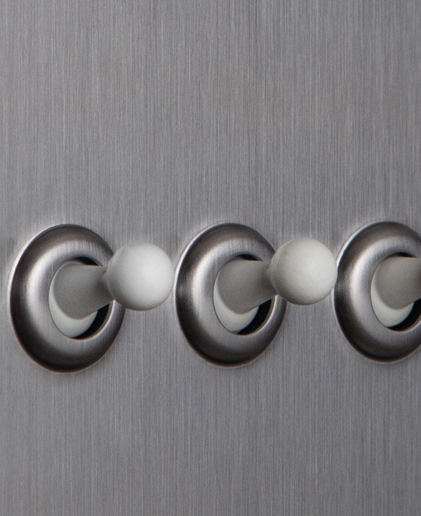 closeup of silver and white quadruple toggle switch