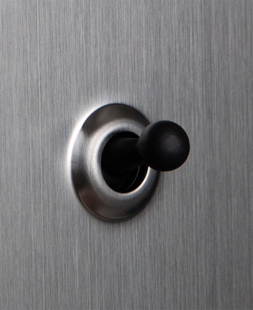 closeup of silver and black single toggle