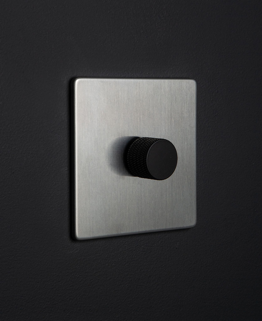 silver and black single dimmer against blacl background