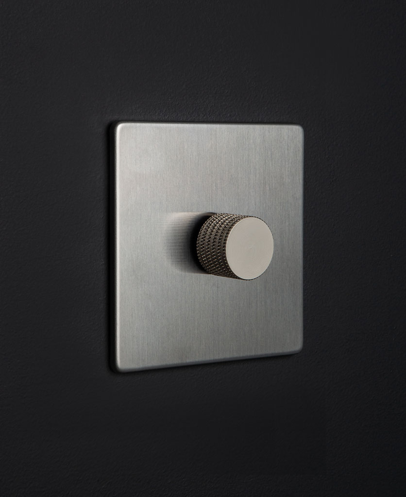 Silver dimmer switch with silver knurled knob detail