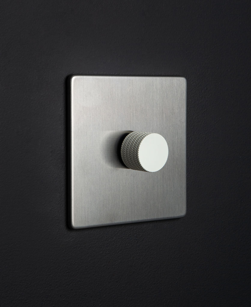 silver and white single dimmer against black background