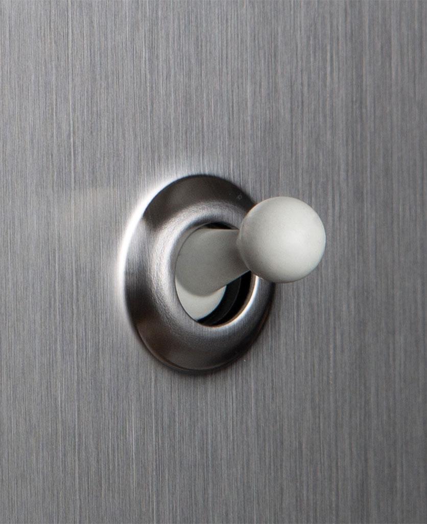 closeup of silver and white single toggle