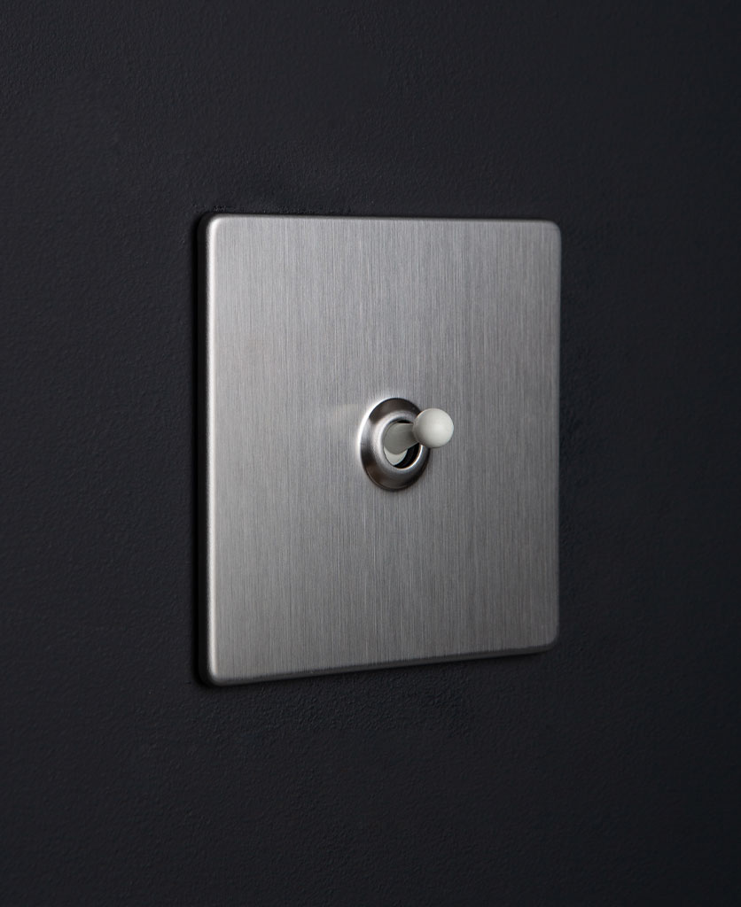silver and white single toggle against black background